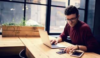 Man works remotely on a laptop