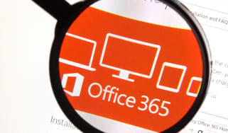 Office 365 logo being viewed through a magnifying glass