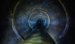 A dark sewer tunnel