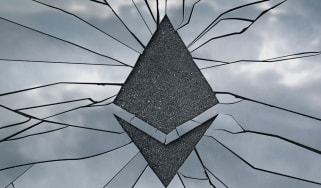 Ethereum cryptocurrency logo engraved on broken glass to show a security failure