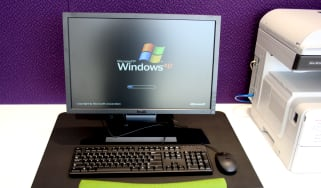 A desktop computer with the Microsoft Windows XP operating system loading on its screen.