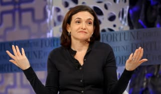 Sheryl Sandberg with hands up