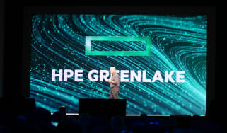 HPE CEO Antonio Neri on stage at HPE Discover 2019 Las Vegas in front of GreenLake text