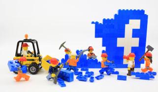 Lego builders dismantling the Facebook logo