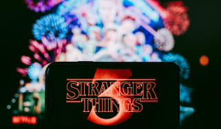 Stranger Things logo shown on a smartphone