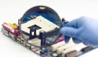Image of a motherboard being examined closely