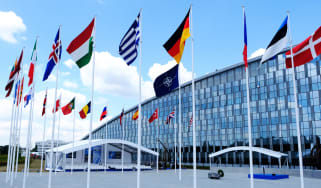A shot of the NATO headquarters surrounded by European flags