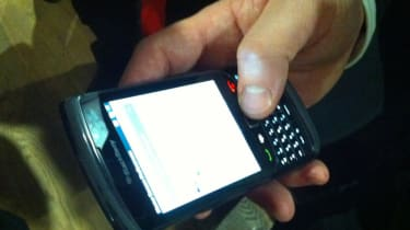 The BlackBerry Torch 9800 in hand