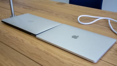 The Dell XPS 13 and Apple MacBook Pro 13in (2018) side-by-side with the lids closed