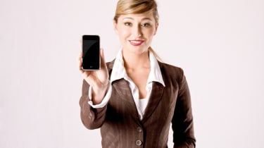 Business woman with iPhone in hand