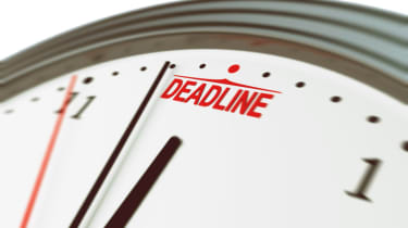 Clock approaching deadline time