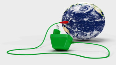Mobile phone charger plugged into globe