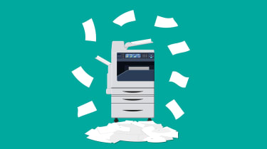 Piles of paper around an office MFP printer