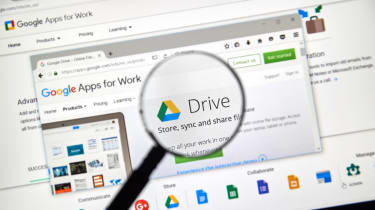 G Suite on laptop under a magnifying glass