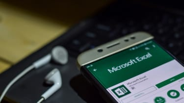 The Microsoft Excel app on a mobile phone with headphones plugged in