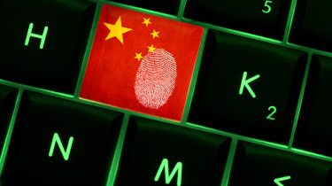 Fingerprint on a Chinese key on a keyboard to denote cyber crime