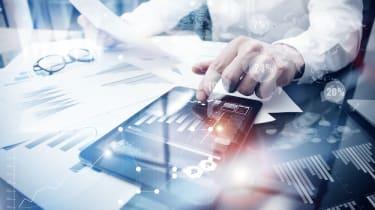 Man processes data at desk