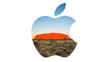 The Apple logo superimposed over Uluru in Australia, also known as Ayer's Rock