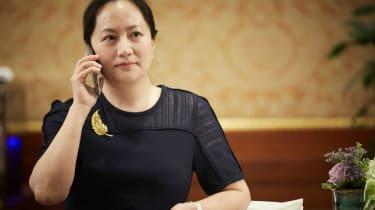 Huawei CFO Meng Wanzhuo chatting on the phone