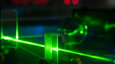An experiment involving a green laser that aims to show photons can behave as both a particle and a wave