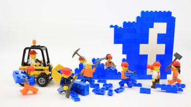 Lego builders dismantling the Facebook logo