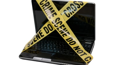 Computer covered in police tape