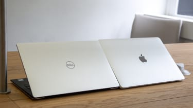 The Dell XPS 13 and Apple MacBook Pro 13in (2018) side-by-side with the lid half-open