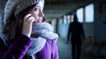 Woman on phone worried about the pervert stalking her