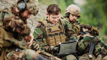 Troops using laptop