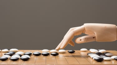 Wooden hand playing Go