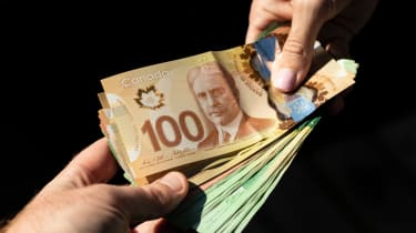 Canadian Dollars being handed over