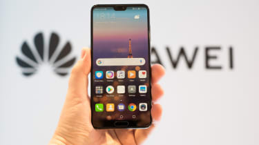 Huawei phone in front of logo