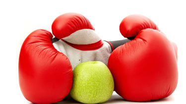Apple in boxing gloves