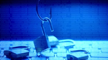 Padlock being lifted by a fishing hook on a blue background to symbolise phishing attacks