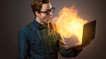 Guy with laptop on fire