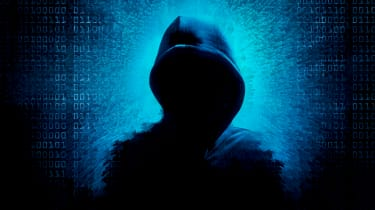 An image of a shadowed hooded hacker on a blue background