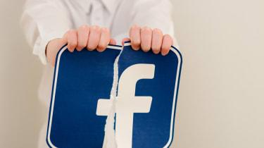 Facebook sign being torn up