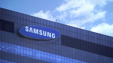 Samsung sign on headquarter building with sky in background