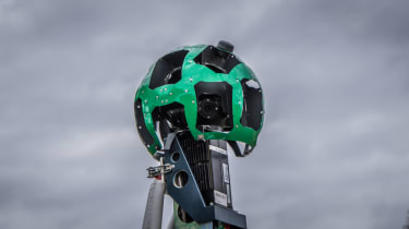 The Google Street View Camera against a stormy background